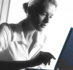 MODEL RELEASED. Laptop computing. Woman using a laptop computer. Picture from Image Quest