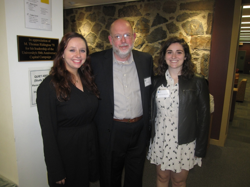 Library Director and Friends President Jim Sauer with Abbie Storch and Bessa Houseknecht, two of our three essay winners.